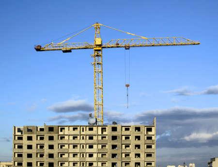 Hoisting crane on sunny weather photo