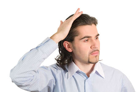 preens: Young handsome dark haired caucasian man in light blue striped shirt preens himself isolated on white