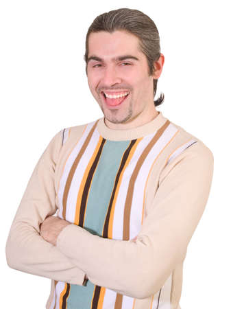 Young dark haired caucasian man in striped sweater making silly face and showing tongue isolated on white photo