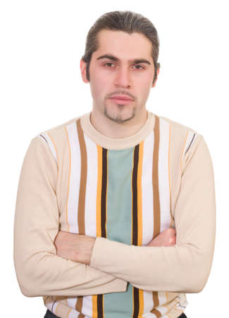Serious dark haired caucasian man with hands folded on chest in striped sweater isolated photo
