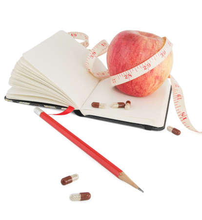 Diary with fruit and biologically active supplement in pills for efficient dieting photo