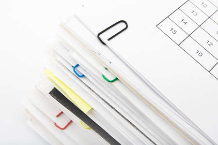 Big pile of different coloured office papers in files and folders on white background Stock Photo - 4894945