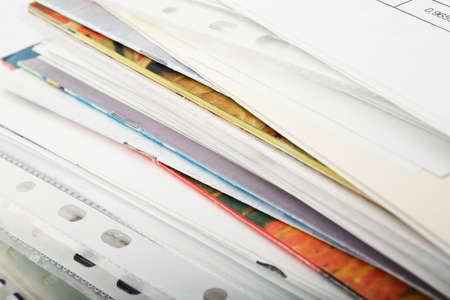 Big pile of different coloured office papers in files and folders on white background Stock Photo - 5075157