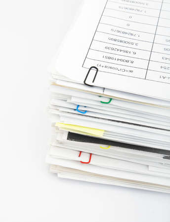 Big pile of different coloured office papers in files and folders on white background Stock Photo - 5234580
