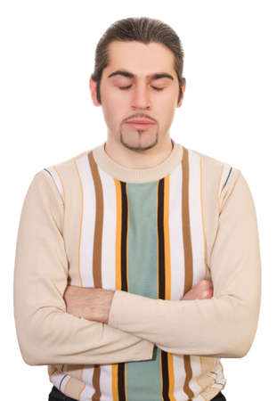 Young dark haired caucasian man in striped sweater sitting with folded hands and thinking isolated on white photo