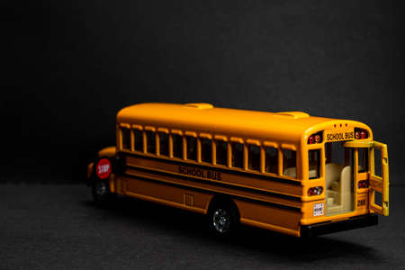 School bus model with stop sign. Do not pass the school bus. The stop signal arm. The stop signal arm. The school bus display a stop signal. Banque d'images