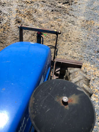 The tractor is adjusting the soil with front dozer, slow speed, Over the front top view.
