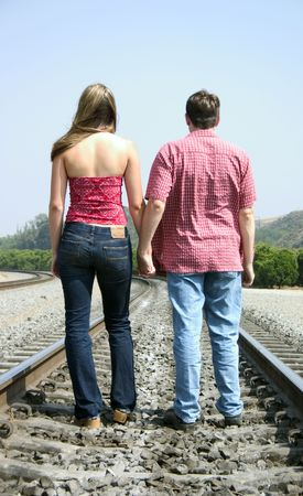 hand rails: Couple on Tracks Stock Photo