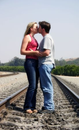 women kissing: Kissing on Tracks Stock Photo
