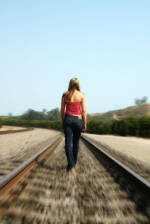 Girl on Tracks Stock Photo