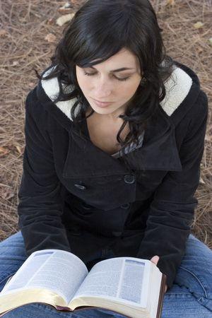 to lap: Woman Reading Bible