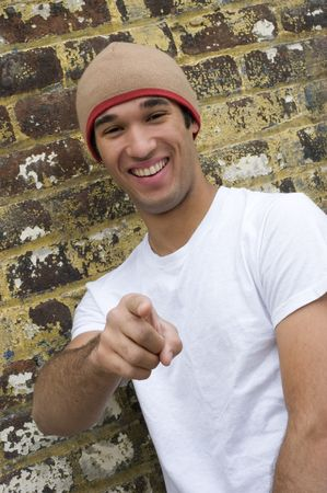 beanies: Pointing Laughing Man Stock Photo