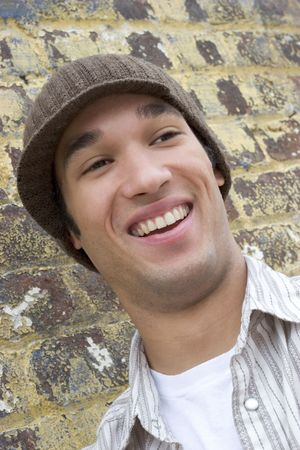 beanies: Laughing Young Man Stock Photo
