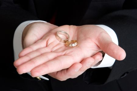 Hand Holding Rings Stock Photo