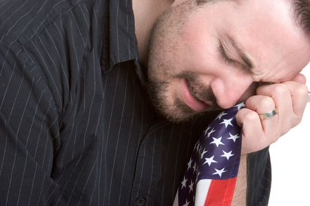 Man Weeping over Flag photo