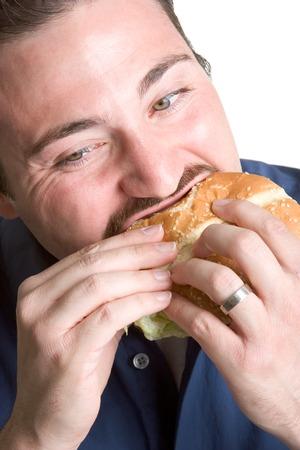 man with a goatee: Hamburger Bite