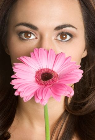 Woman Holding Pink Daisy photo