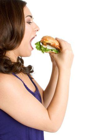 femme bouche ouverte: Femme de manger un hamburger