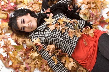 Girl in Leaves Stock Photo - 2114002