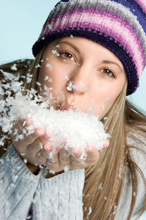 girl blowing: Girl Blowing Snow