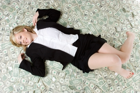 Woman Laying in Money Stock Photo - 2297028