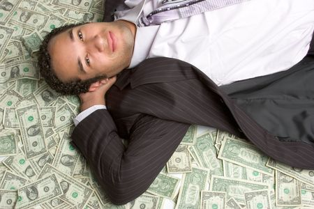 Man Laying in Money