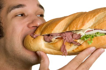 adult sandwich: Eating a Sandwich Stock Photo