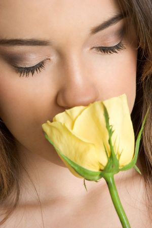 Woman Smelling Rose Stock Photo - 2583592