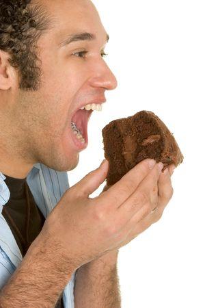 Hombre comiendo pastel de chocolate  Foto de archivo - 2658257