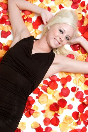 Woman Laying in Rose Petals Stock Photo - 3199731