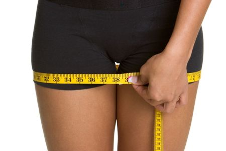 Woman Measuring Thighs photo