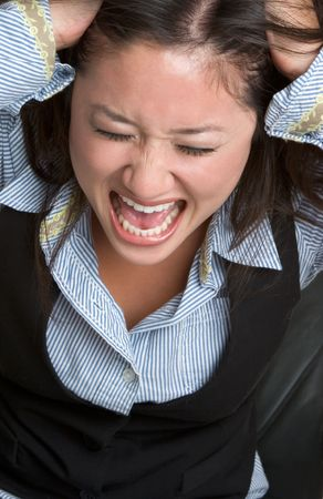pulling hair: Angry Businesswoman Stock Photo