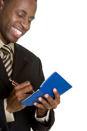 hombre escribiendo: El hombre sonriente escribir cheques  Foto de archivo