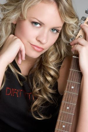 rockstars: Woman Holding Guitar LANG_EVOIMAGES