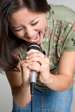 kareoke: Woman Yelling in Microphone Stock Photo