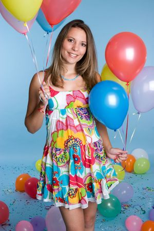 Young Woman Holding Balloons Stock Photo