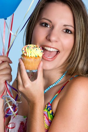Woman Eating Cupcake Stock Photo - 3660784