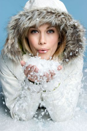 Woman Blowing Snow Stock Photo - 3930137
