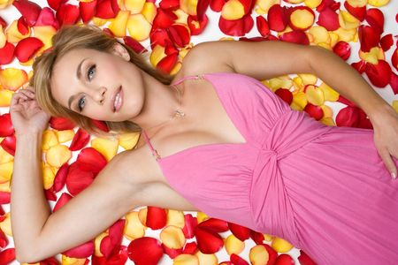 Woman Laying in Rose Petals Stock Photo - 3928691