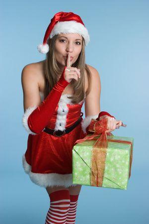Woman Holding Christmas Present 版權商用圖片