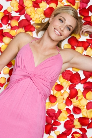 Woman Laying in Rose Petals Stock Photo - 3967500