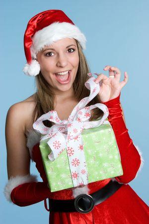 Santa Opening Gift Stock fotó - 3967740
