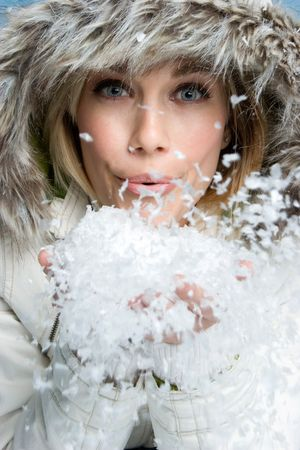 Girl Blowing Snow Stock Photo - 3967742