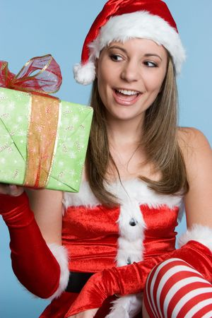 Girl Holding Christmas Present Stock Photo - 3999336