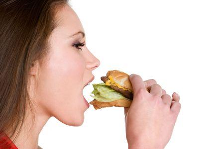 Vrouw Eating Hamburger Stockfoto