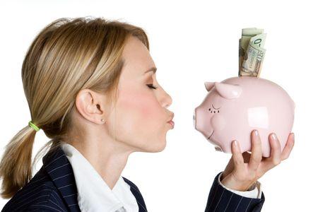 Woman Kissing Piggy Bank Banco de Imagens