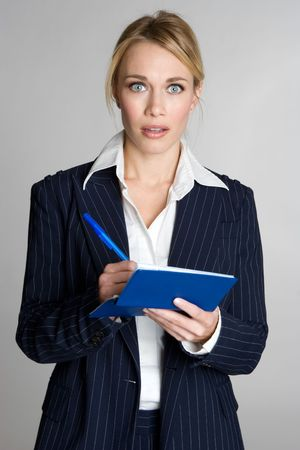 adult writing: Shocked Woman Writing Checks