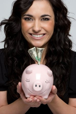 Girl Holding Piggy Bank Stock Photo - 4312958