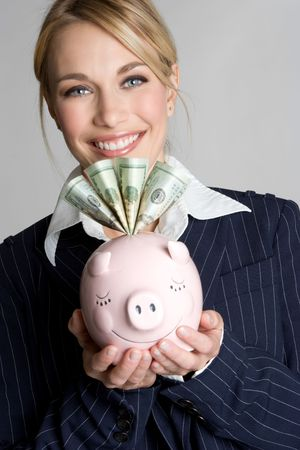 Businesswoman With Piggy Bank Stock Photo - 4312960