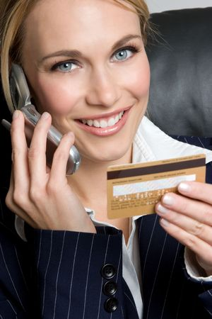 Woman With Credit Card and Phone Stock Photo - 4312956